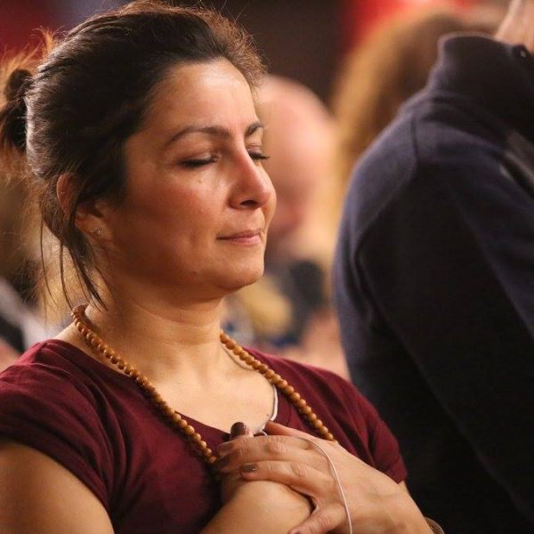 event attendee connecting to higher self